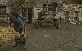 Old farmer has fun with his female employees