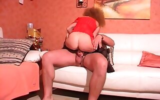 Vintage sex in stockings on a sofa