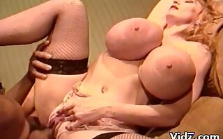 Chessie Vintage Fuck scene - retro blonde pornstar with monster tits gives blowjob